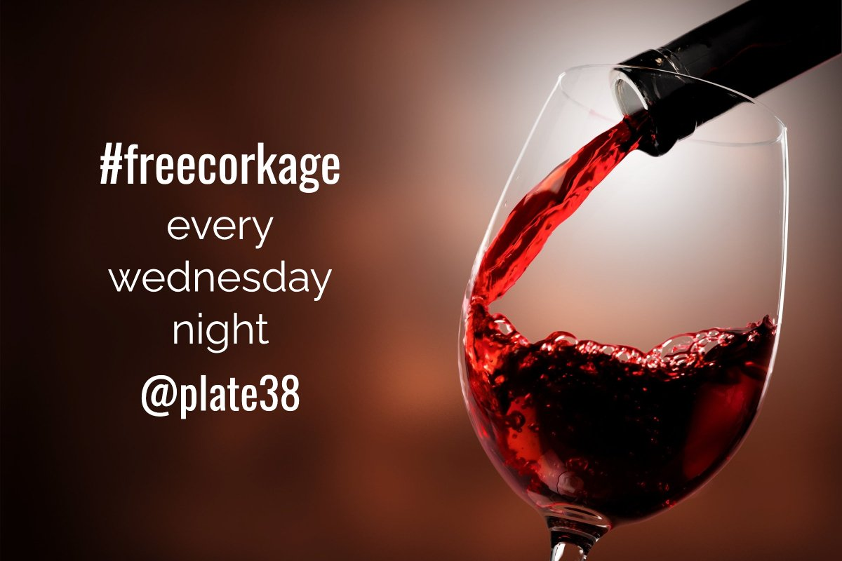 free corkage every wednesday at plate38, pictured red wine poured into wine glass close up