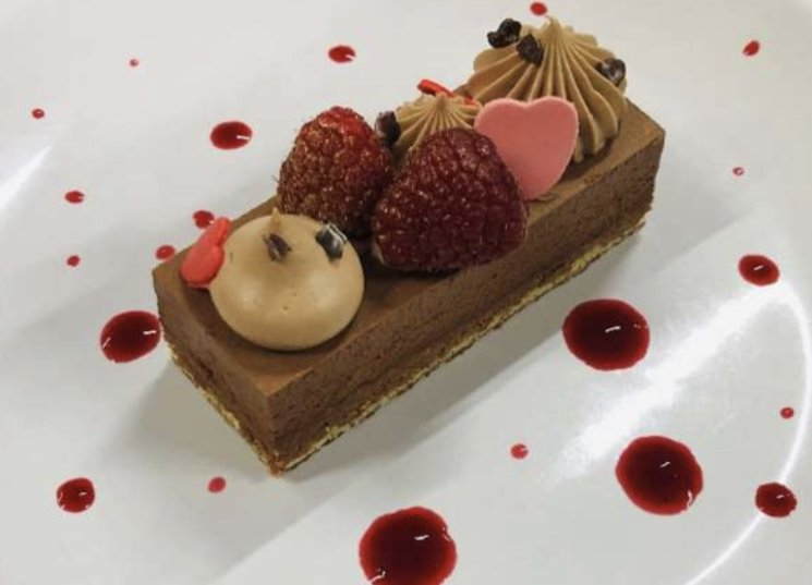 a serving of delicious chocolate mousse raspberry royale